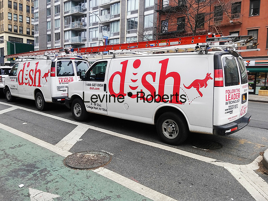 Dish Network satellite television service vehicles in New York on Saturday, April 9, 2016. TV and communication companies are consolidating as the line between the services blurs. (© Richard B. Levine)