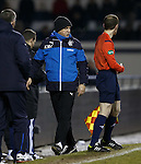 Kenny McDowall and the linesman having a chat