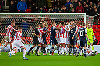 11th January 2020; Bet365 Stadium, Stoke, Staffordshire, England; English Championship Football, Stoke City versus Milwall FC; Shaun Williams of Millwall in the middle of the pack after a bad tackle - Strictly Editorial Use Only. No use with unauthorized audio, video, data, fixture lists, club/league logos or 'live' services. Online in-match use limited to 120 images, no video emulation. No use in betting, games or single club/league/player publications