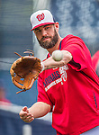 21 May 2014: Washington Nationals outfielder Kevin Frandsen tosses on the sidelines prior to a game against the Cincinnati Reds at Nationals Park in Washington, DC. The Reds edged out the Nationals 2-1 to take the rubber match of their 3-game series. Mandatory Credit: Ed Wolfstein Photo *** RAW (NEF) Image File Available ***