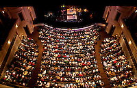 A crowded audience listens to performers at the 20th year of the Tosco Music Party, held at the Overcash Academic and Performing Arts Center Dale F. Halton Theater Central Piedmont Community College. The annual event, named after John Tosco, owner of the Tosco Music Studio, is designed to showcase professional and amateur musicians.