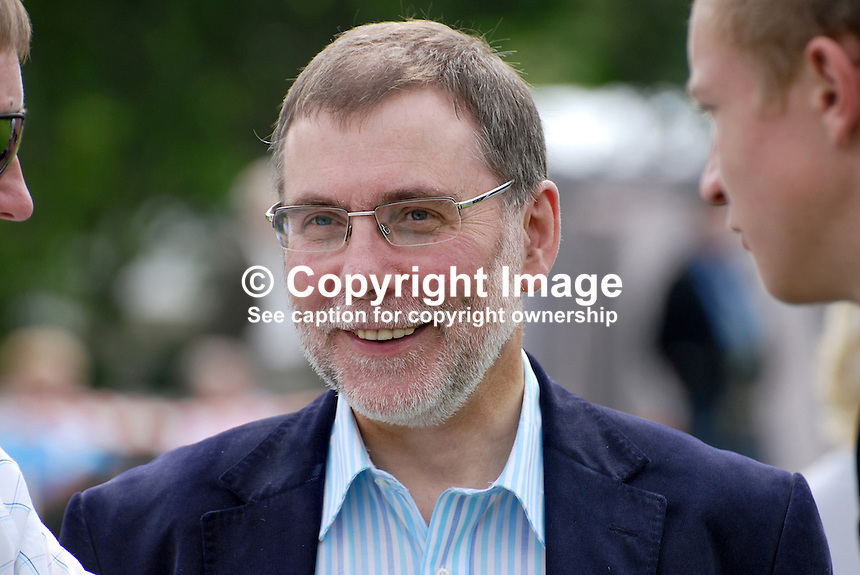 European Pipe Band Championships at Stormont Estate, Belfast, N Ireland, on 30 July 2011. Nelson McCausland, Minister for Social Development, N Ireland Assembly, asssemblyman, DUP, Democratic Unionist Party, tieless and in relaxed mood, was an attendee. 201107304776...Copyright Image from Victor Patterson, 54 Dorchester Park, Belfast, UK, BT9 6RJ..Tel: +44 28 9066 1296.Mob: +44 7802 353836.Voicemail +44 20 8816 7153.Skype: victorpattersonbelfast.Email: victorpatterson@me.com.Email: victorpatterson@ireland.com (back-up)..IMPORTANT: If you wish to use this image or any other of my images please go to www.victorpatterson.com and click on the Terms & Conditions. Then contact me by email or phone with the reference number(s) of the image(s) concerned.