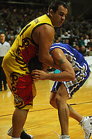 Pero Cameron gets to grips with Brendon Polybank during game two of the NBL Final basketball match between the Wellington Saints and Waikato Pistons at TSB Bank Arena, Wellington, New Zealand on Friday 20 June 2008. Photo: Dave Lintott / lintottphoto.co.nz