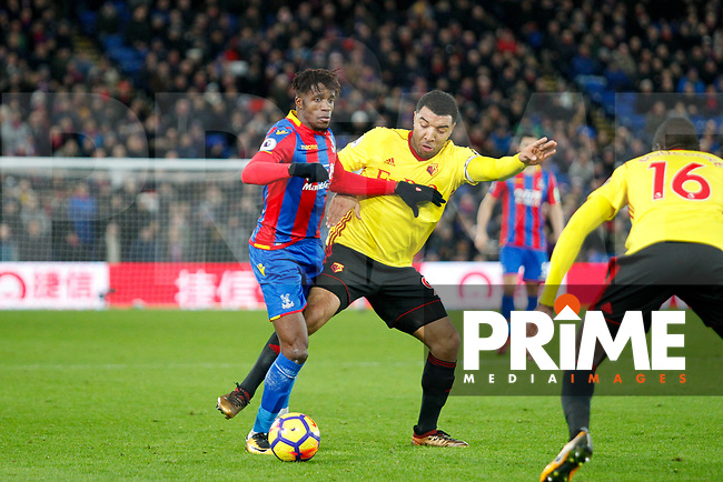 Wilfried Zaha of Crystal Palace battles Troy Deeney of Watford during the Premier League match between Crystal Palace and Watford at Selhurst Park, London, England on 13 December 2017. Photo by Carlton Myrie / PRiME Media Images.