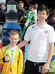 Grove Rangers captain Sam Victory is presented with the player of the match award from Drogheda United's Chris Kerr after his under 10 team beat Grove Rangers at the Drogheda and District schoolboys cup finals in Hunky Dorys park. Photo: Colin Bell/pressphotos.ie