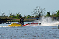 Frame 3: Terry Rinker (#10) and Chris Fairchild (#62) race up the back stright to turn 2 where Rinker's boat rolls over a wake, noses in and flips.   (Formula 1/F1/Champ class)