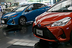 Toyota Motor Corporation's vehicles on display at TMC's headquarters building where Senior Managing officers Tetsuya Otake and Nobuhiko Murakami attend a news conference to announce their first quarter financial results on August 4, 2017, Tokyo, Japan. They announced an increase in the number of vehicles sold versus the same period last year, and also an increase in net income up to 613 .0 billion yen for the quarter compared with 552.4 billion yen the previous year. (Photo by Rodrigo Reyes Marin/AFLO)