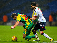 West Bromwich Albion's Craig Dawson is fouled by Bolton Wanderers' Will Buckley<br /> <br /> Photographer Alex Dodd/CameraSport<br /> <br /> The EFL Sky Bet Championship - Bolton Wanderers v West Bromwich Albion - Monday 21st January 2019 - University of Bolton Stadium - Bolton<br /> <br /> World Copyright © 2019 CameraSport. All rights reserved. 43 Linden Ave. Countesthorpe. Leicester. England. LE8 5PG - Tel: +44 (0) 116 277 4147 - admin@camerasport.com - www.camerasport.com