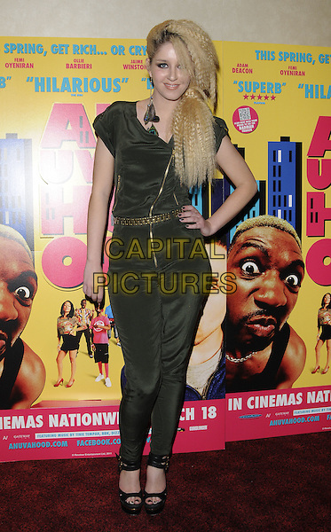 "ESMEE DENTERS .The UK Premiere of ""Anuvahood"", Empire Cinema, Leicester Square, London, England, UK..15th March 2011.full length black grey gray jumpsuit catsuit zip zipper belt gold platform black sandals shoes crimped hair 80s hand on hip .CAP/CAN.©Can Nguyen/Capital Pictures."