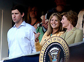 Washington, D.C. - April 14, 2005 -- Jenna Bush, daughter of United States President George W. Bush, shares a thought with her mother, first lady Laura Bush in the Presidential Box at RFK Stadium in Washington, D.C. on April 14, 2005.  Henry Hager is at left..Credit: Ron Sachs / CNP.(RESTRICTION: NO New York or New Jersey Newspapers or newspapers within a 75 mile radius of New York City)