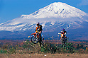 French Cyril Despres and Yoshio-san steer their KTM off-road motorcycles at the foot of Mount Fuji (Japan) on November 2001. (Photo credit Laurent Benchana/Nippon News)