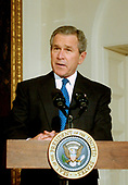 United States President George W. Bush makes remarks prior to participating in the lighting of a Chanukah Menorah in the Booksellers Area in the White House in Washington, DC. on December 22, 2003.<br /> Credit: Ron Sachs / CNP