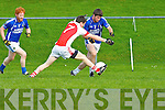 Shane McSweeney Laune Rangers is tackled by Paul Murphy Rathmore during their division 1 clash in Killorglin on Saturday