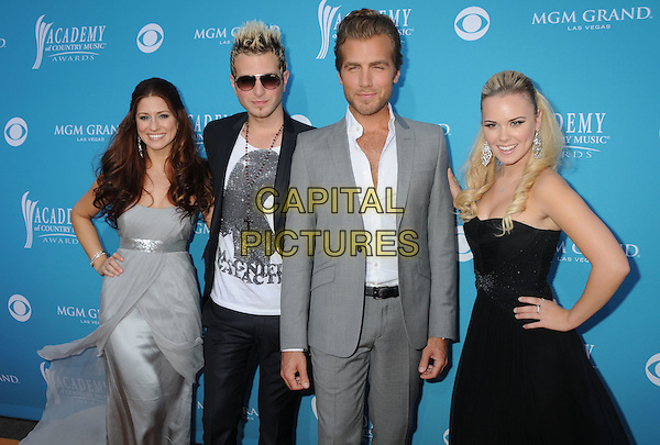 GLORIANA - Rachel Reinert, Mike Gossin, Tom Gossin & Cheyenne Kimball . 45th Annual Academy Of Country Music Awards held at the MGM Grand Garden Arena, Las Vegas, NV, USA..April 18th, 2010.half length silver grey gray black dress suit jacket strapless hand on hip sunglasses shades white shirt.CAP/ADM/BP.©Byron Purvis/AdMedia/Capital Pictures.