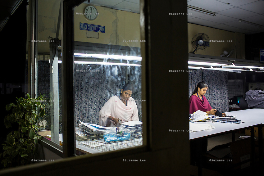 Workers working on textiles in the Shade Continuity Section of the Pratibha vertically integrated garment unit in Indore, Madhya Pradesh, India on 11 November 2014. Photo by Suzanne Lee for Fairtrade
