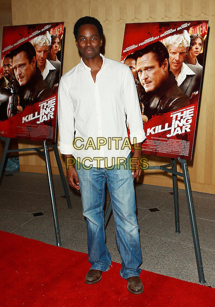 HAROLD PERRINEAU.Los Angeles Premiere of The Killing Jar  held at the Clarity Theatre, Beverly Hills, California, USA..March 17th, 2010.full length white shirt jeans denim check checked.CAP/ADM/TC.©T. Conrad/AdMedia/Capital Pictures.