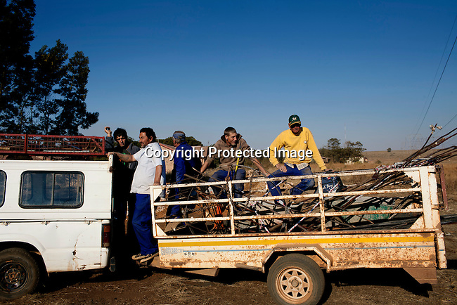KLEINFONTEIN, SOUTH AFRICA - JULY 15: Municipality workers leaves a sewage construction site on July 15, 2013 in Kleinfontein outside Pretoria, South Africa. The all white town with about one thousand residents are all Afrikaners with a Vortrekker heritage. Only white Afrikaners who share Afrikaner culture, language and religion are allowed to settle in the town.  (Photo by: Per-Anders Pettersson)