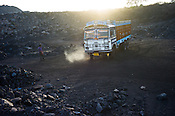 Trucks wait to load up the coal at the Goladi Depot in Jharia, Jharkhand, India.
