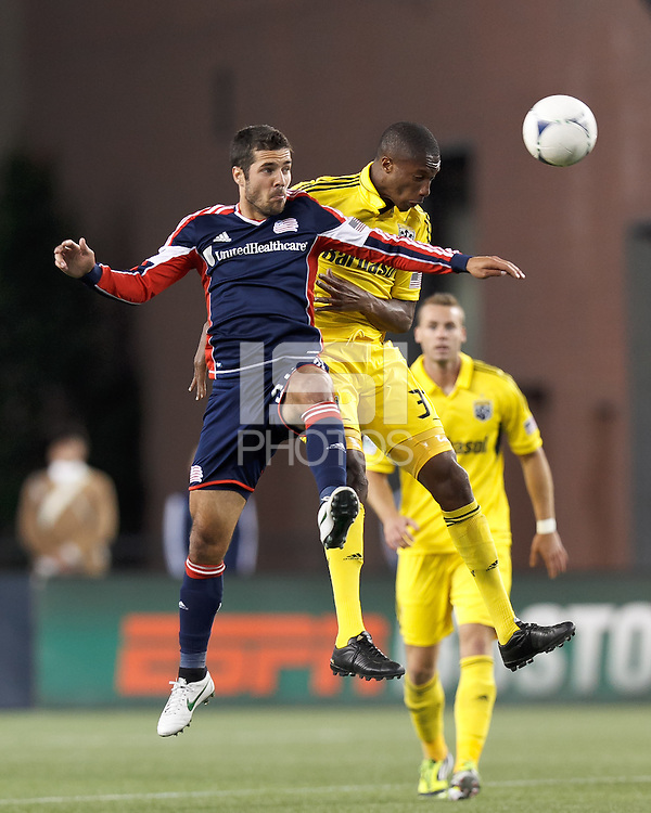 New England Revolution forward Benny Feilhaber (22) and Columbus Crew midfielder Kevan George (37) battle for head ball. In a Major League Soccer (MLS) match, the New England Revolution tied the Columbus Crew, 0-0, at Gillette Stadium on June 16, 2012.