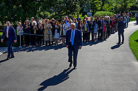 United States President Donald J. Trump walks towards the media to make remarks and answer questions as he departs the South Lawn of the White House in Washington, DC for a day of activities in San Antonio, Texas and Houston, Texas on April 10, 2019.<br /> CAP/MPI/RS<br /> &copy;RS/MPI/Capital Pictures