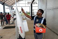 RWANDA, Gitarama, Muhanga, zipline drone airport , zipline is a american start-up and delivers Blood preserve and medical drugs by drone to rural health centers, the battery driven Zip 2 can travel at a top speed around 79 miles per hour, carrying 3.85 pounds of cargo and has a range of 160 km round trip, the delivery box is dropped by a small parachute, the parcel with blood preserves is packed in the drone / RUANDA, Gitarama, Muhanga, zipline Drohnen Flugstation, zipline ist ein amerikanisches start-up und transportiert Blutkonserven und Medikamente mit Drohnen wie der Zip 2 zu ländlichen Krankenstationen, die Zip 2 hat fuer einen Rundflug eine Reichweite von 130 km, die Batterie betriebene und ferngesteuerte Drohne wirft die Sendung per Fallschirm ab, Verpackung einer Bestellung in Kartonbox mit Fallschirm, scan mit smartphone