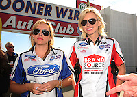Nov. 13, 2011; Pomona, CA, USA; NHRA drivers Brittany Force (left) and Courtney Force during the Auto Club Finals at Auto Club Raceway at Pomona. Mandatory Credit: Mark J. Rebilas-.