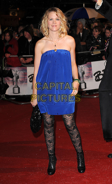EDITH BOWMAN.Arrivals the Brit Awards 2010 held at Earls Court, London, England..February 16th 2010 .Brits full length blue strapless dress black lace pattern tights  ankle boots clutch bag .CAP/BEL.©Tom Belcher/Capital Pictures.