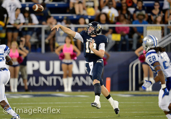 Florida International University football player quarterback Jake Medlock (12) plays against Middle Tennessee State University on October 13, 2012 at Miami, Florida. MTSU won the game 34-30. .