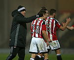 Chris Wilder manager of Sheffield Utd greets his players during the Checkatrade Trophy match at Blundell Park Stadium, Grimsby. Picture date: November 9th, 2016. Pic Simon Bellis/Sportimage
