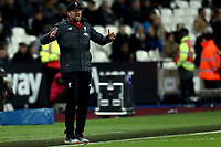 29th January 2020; London Stadium, London, England; English Premier League Football, West Ham United versus Liverpool; Liverpool Manager Jurgen Klopp gets anxious as time goes deep into the 2nd half