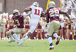 North Carolina State wide  receiver Jakobi Meyers cuts between Florida State defensive back Derwin James (3) and Nat Andrews for a 71 yard catch and run for a touchdown late in the first half of an NCAA college football game in Tallahassee, Fla., Saturday, Sept. 23, 2017.  (AP Photo/Mark Wallheiser)