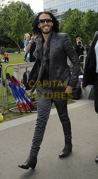 "RUSSELL BRAND.At a photocall for ""Get Him To The Greek"", Tower Bridge, London, England, UK..June 20th 2010.full length grey gray suit hairy chest sunglasses shades beard facial hair skull scarf jacket alexander mcqueen print silk walking .CAP/CAN.©Can Nguyen/Capital Pictures."