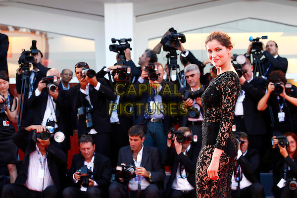 Laetitia Casta.The Opening Ceremony of the 69th Venice International Film Festival at Palazzo del Cinema, Venice, Italy. .August 29th, 2012 .half length black lace dress see through thru bra underwear knickers side photographers press .CAP/IPP/GR.©Gianluca Rona/IPP/Capital Pictures.