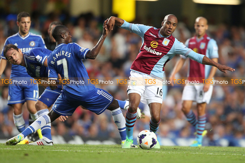 Fabian Delph of Aston Villa challenged by Ramires of Chelsea - Chelsea vs Aston Villa - Barclays Premier League Football at Stamford Bridge, Fulham Road, London - 21/08/13 - MANDATORY CREDIT: Simon Roe/TGSPHOTO - Self billing applies where appropriate - 0845 094 6026 - contact@tgsphoto.co.uk - NO UNPAID USE