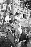 Shatila, the &quot;gipsy camp&quot; below the Sports city of Beirut. Children are having fun...<br />  <br /> Chatila, camp des &quot;Nouri&eacute;&quot; (Tsiganes). Les enfants s'amusent...