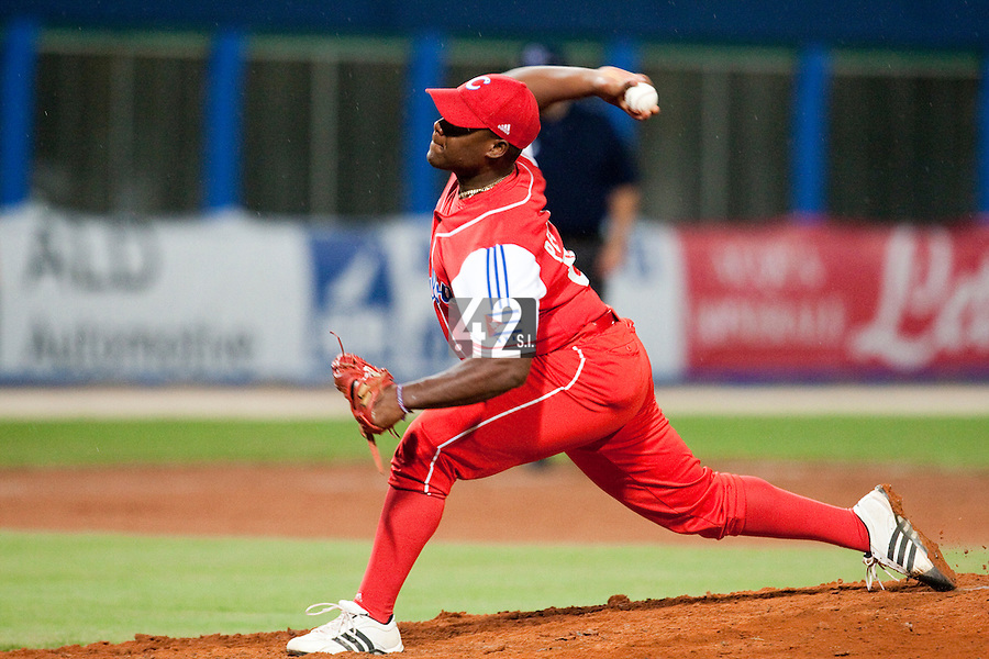 24 September 2009: Yadier Pedroso of Cuba pitches against Team USA during the 2009 Baseball World Cup final round match won 5-3 by Team USA over Cuba, in Nettuno, Italy.