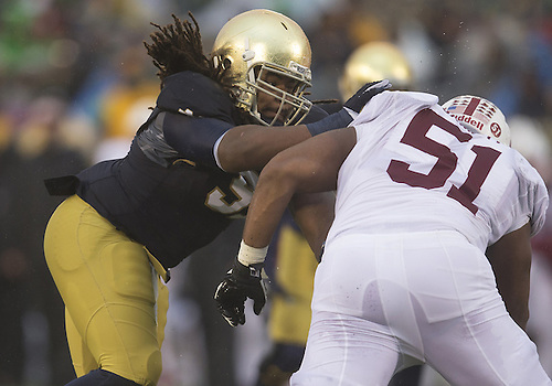 October 04, 2014:  Notre Dame defensive line Sheldon Day (91) and Stanford offensive lineman Joshua Garnett (51) battle at the line of scrimmage during NCAA Football game action between the Notre Dame Fighting Irish and the Stanford Cardinal at Notre Dame Stadium in South Bend, Indiana. Notre Dame defeated Stanford 17-14.