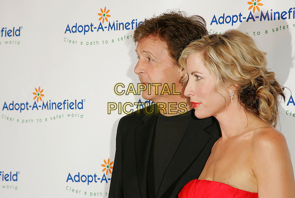 SIR PAUL McCARTNEY & HEATHER MILLS McCARTNEY.The 4th Annual Benefit Gala for Adopt-A-Minefield held at The Century Plaza Hotel in Century City, California.October 15th, 2004.headshot, portrait, married, husband, wife, red strapless, red lipstick, profile.www.capitalpictures.com.sales@capitalpictures.com.©Debbie Van Story/Capital Pictures