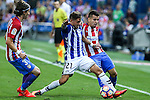 Atletico de Madrid's Angel Correa and Filipe Luis and Deportivo Alaves's Kiko Femenia during the match of La Liga Santander between Atletico de Madrid and Deportivo Alaves at Vicente Calderon Stadium. August 21, 2016. (ALTERPHOTOS/Rodrigo Jimenez)