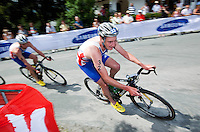 24 JUN 2012 - KITZBUEHEL, AUT - Alistair Brownlee (GBR) of Great Britain (right) leads brother Jonathan Brownlee during the bike at the elite men's 2012 World Triathlon Series round in Schwarzsee, Kitzbuehel, Austria (PHOTO (C) 2012 NIGEL FARROW)