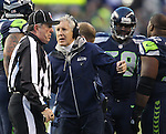 Seattle Seahawks Head Coach Pete Carroll, left, argues a call with Umpire Jeff Rice during their game against the St. Louis Rams at CenturyLink Field in Seattle, Washington on December 30, 2012.   The Seahawks came from behind to beat the Rams 20-13.    © 2102.  Jim Bryant Photo. All Rights Reserved.