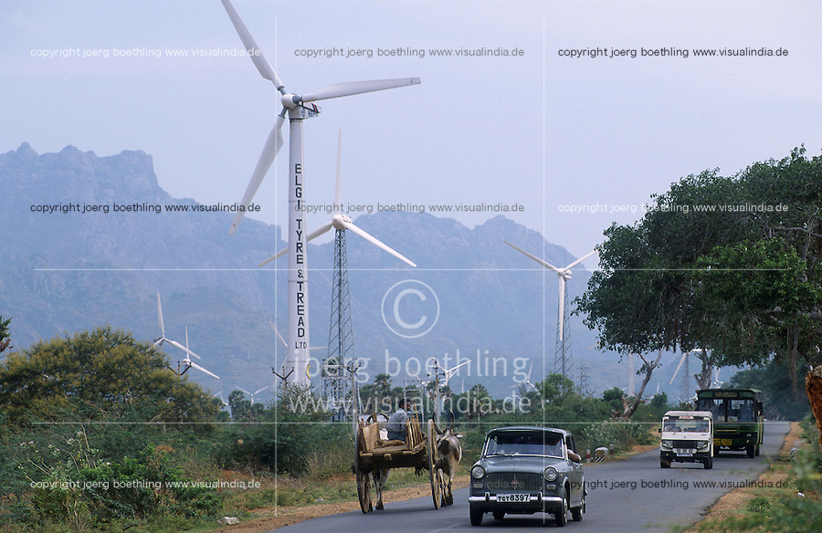 INDIA Tamil Nadu Cape Comorin, contrast modern between traditional, farmer with bullock cart and site for wind turbines / INDIEN Kap Komorin, Strassenverkehr vor Windpark