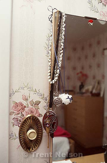 Jewelry on mirror in Allie's room in the Robinson house<br />