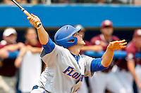 June 11, 2011:   Florida Gators inf/of Preston Tucker (25) follows through on a fly ball during NCAA Gainesville Super Regional Game 2 action between Florida Gators and Mississippi State Bulldogs played at Alfred A. McKethan Stadium on the campus of Florida University in Gainesville, Florida.   Mississippi State defeated Florida 4-3.........