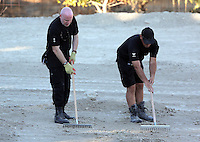 Pictured: Detective Inspector of South Yorkshire Police (L) helps sift through soil in Kos, Greece. Thursday 06 October 2016<br />