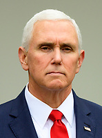 United States Vice President Mike Pence listens as US President Donald J. Trump makes a statement following his meeting with Democratic leaders in the Situation Room of the White House in Washington, DC in an effort to break the political impasse on border security and reopen the federal government on Friday, January 4, 2018.  The President also took questions from reporters. Photo Credit: Ron Sachs/CNP/AdMedia