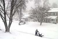 An unidentified man uses a snow blower to clear snow from a sidewalk during Winter Storm Jonas Saturday January 23, 2016 in Warminster, Pennsylvania. (Photo by William Thomas Cain)