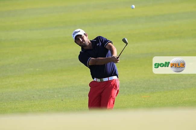 Alexander Levy (FRA) chips onto the 10th green during Thursday's Round 2 of the 2015 Commercial Bank Qatar Masters held at Doha Golf Club, Doha, Qatar.: Picture Eoin Clarke, www.golffile.ie: 1/22/2015