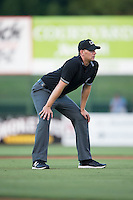 Umpire Joe Schwartz handles the calls on the bases during the South Atlantic League game between the Hickory Crawdads and the Kannapolis Intimidators at Kannapolis Intimidators Stadium on June 11, 2016 in Kannapolis, North Carolina.  The Crawdads defeated the Intimidators 7-5.  (Brian Westerholt/Four Seam Images)