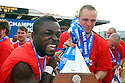 Yemi Odubade and Chris Beardsley of Stevenage Borough celebrates with the Blue Square Premier championship trophy after the Blue Square Premier match between Stevenage Borough and York City at the Lamex Stadium, Broadhall Way, Stevenage on Saturday 24th April, 2010..© Kevin Coleman 2010 ..